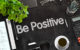 Positive Attitude. Business Concept Handwritten on Black Chalkboard. Top View Composition with Chalkboard and Office Supplies. 3d Rendering. Toned Image.
